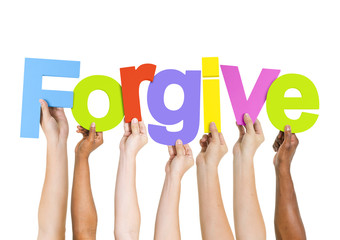 Multi-Ethnic Group of Diverse People Holding The Word Forgive