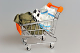 Shopping cart with clothes on gray