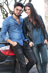 young casual couple with hands in pockets