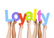 Multi Ethnic People Holding The Word Loyalty