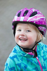 Beautiful vivacious young girl with a joyful smile
