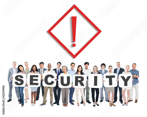 Multi-Ethnic Group Of People Holding The Word Security
