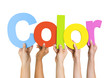 Multi Ethnic People Holding The Word Color