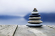 Leinwanddruck Bild - Zen Balancing Pebbles Next to a Misty Lake