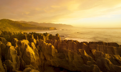 Panaroma of Pancake Rocks in Scenic View of Mountains