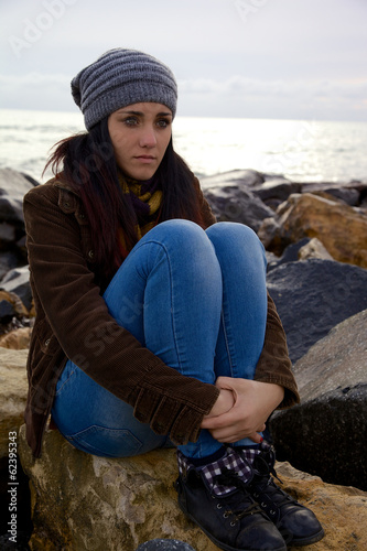 Cute young woman thinking feeling emotion