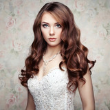 Portrait of beautiful sensual woman with elegant hairstyle. Wedd