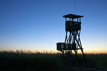 Lookout tower at sunset with dark blue sky