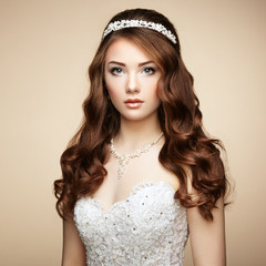 Portrait of beautiful sensual woman with elegant hairstyle. Wedd
