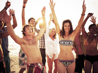 Group of People Enjoying a Summer Beach Party
