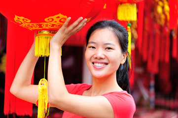 young woman hold a chinese red lantern wishing a happy  new year