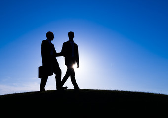 Two Businessman Discussing During Sunset