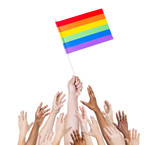 Group Diverse Hands Holding the Flag of Gay Rights