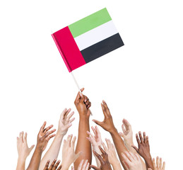 People Holding United Arab Emirates Flag