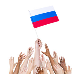 Diverse Hands Holding The Flag of Russia