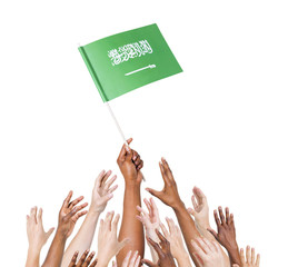 Diverse Hands Holding The Flag of Saudi Arabia