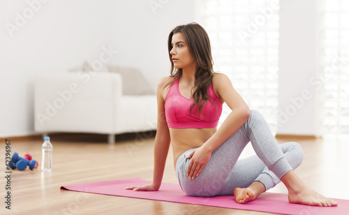 Serious woman doing relaxation exercise at home