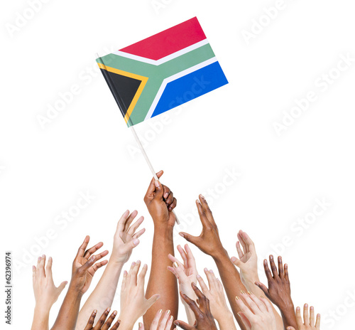 Diverse Hands Holding The South African Flag