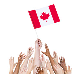 Diverse People Holding The Canadian Flag