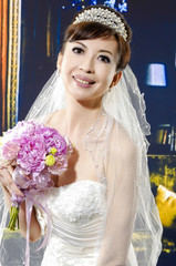 beautiful bride with a bouquet of flowers in studio