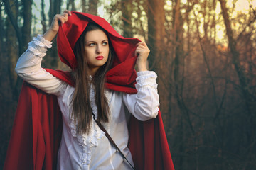 Dark portrait of Little red riding hood