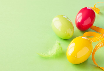 Easter background - colourful glossy eggs on green