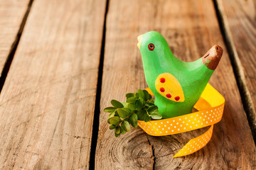 Rustic easter decoration - green bird with buxus on vintage wood