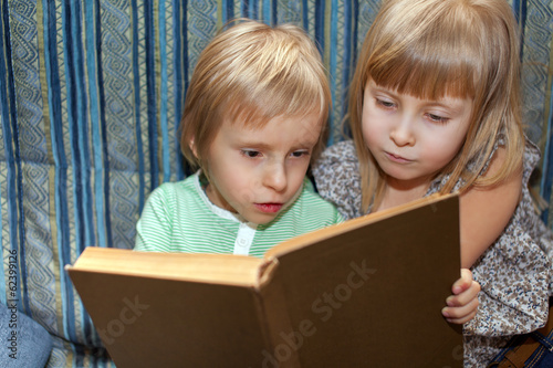 Boy and girl are reading book
