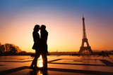 Fototapety loving couple kissing on Eiffel Tower background, Paris, France