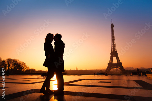 Poster, Tablou loving couple kissing on Eiffel Tower background, Paris, France