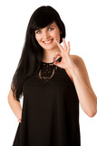 Attractive young woman showing ok sign with thumb up