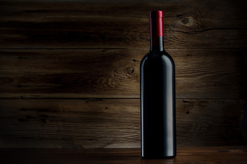 bottle of wine on a wooden background