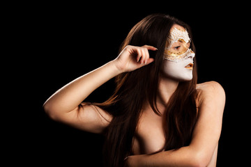 pensive girl's face in a mask on a black background