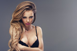 Beautiful sexy blonde woman wearing black sensual lingerie