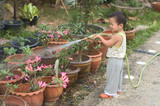 Child watering flower pot