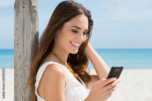 Smiling Girl Reading sms