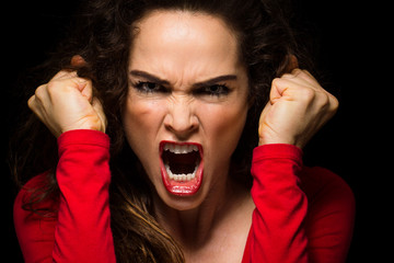Very angry woman clenching fists