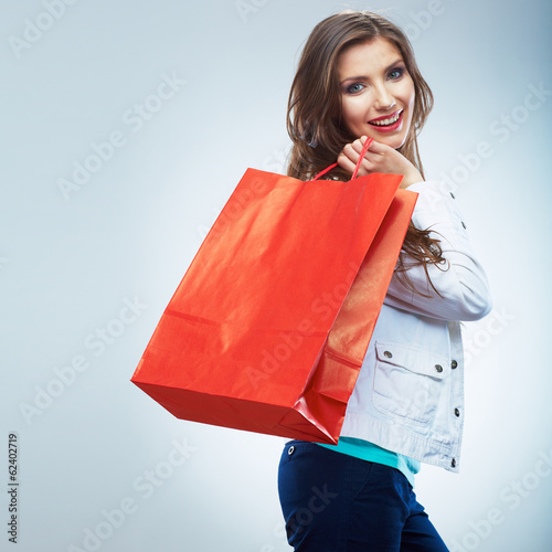 Portrait of happy smiling woman hold shopping bag. Female mode
