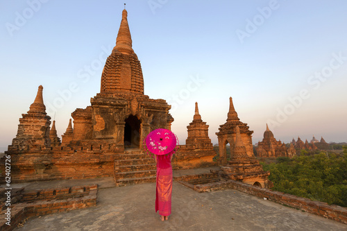 Beautiful burmese dressed lady in front of temple, Bagan