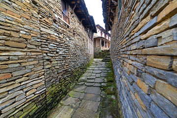 Narrow alley between stone houses