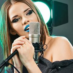 Model rock star singer. Sound studio