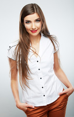 Young casual woman style isolated over white background.