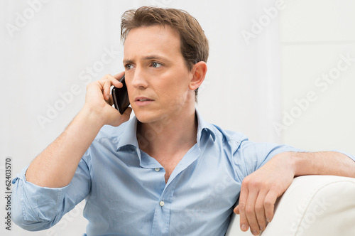 Serious Man Talking On Phone