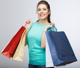 Happy woman hold shopping bag. Studio isolated portrait