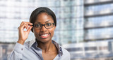 Black woman holding her eyeglasses