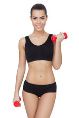 Happy fitness woman exercising with  dumbbells