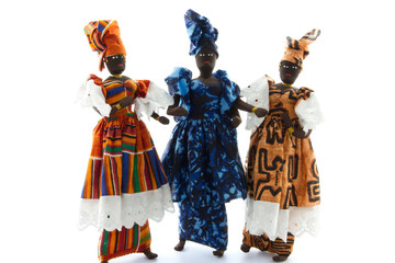 African dolls wearing traditional colorful costumes isolated