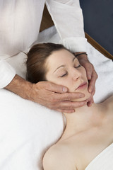 male practitioner relieving headache
