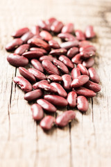 Red beans on wooden background