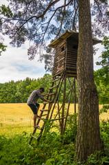 Man Climbing on hunter hut